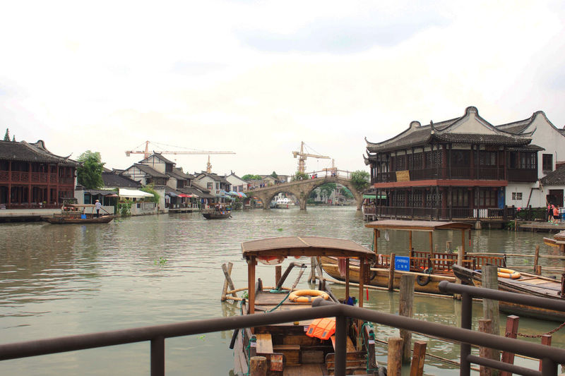 Waiting for the Boat to come… Architecture Boat Built Structure Canal Chinese Culture City Cloud Cloud - Sky Cloudy Day Gondola Harbor Mode Of Transport Nature Nautical Vessel No People Outdoors Rippled Sky Travel Destinations Water