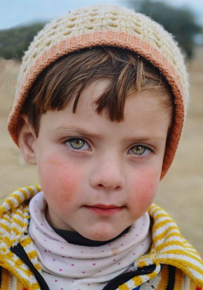Close-up portrait of cute boy with hazel eyes