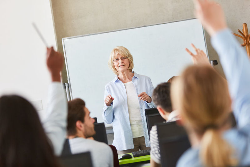 Teacher standing in classroom with students