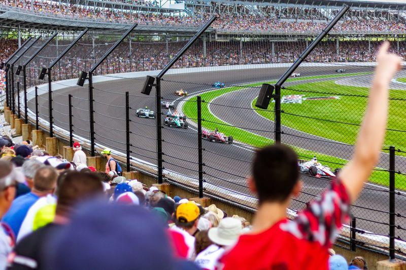Fans watching car racing in stadium