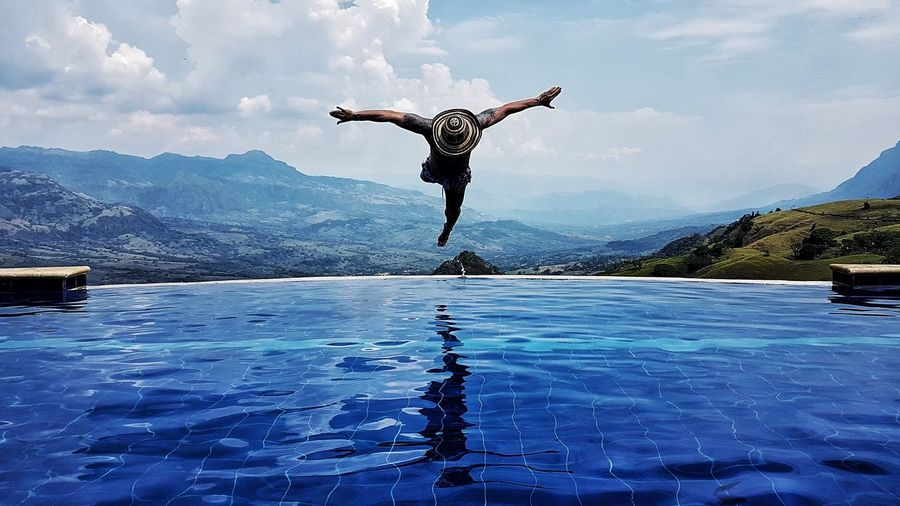 EyeEmNewHere Full Length Water One Person Determination Reflection Skill  Jumping Swimming Pool Mid-air Tranquility Agility Outdoors Scenics People Challenge Day Grace Taking The Plunge Adults Only One Man Only Sommergefühle Perspectives On Nature