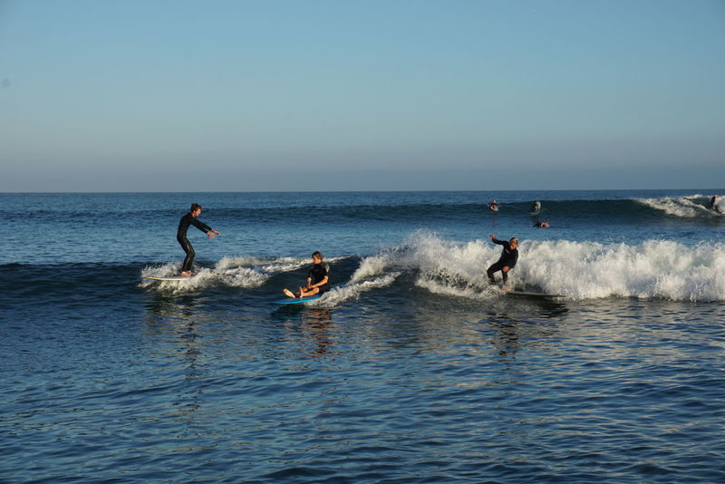 Adventure Enjoyment Extreme Sports Full Length Fun Horizon Over Water Leisure Activity Lifestyles Malibu Beach Men Nature Only Young Men Playing Sea Splashing Sport Surf Surfboard Surfer Surfing Vacations Vitality Water Waterfront Wave