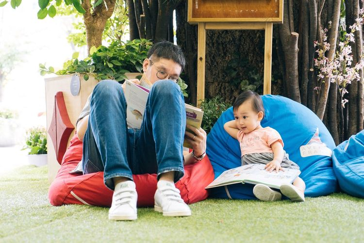 Fatherhood Moments Togetherness Full Length Casual Clothing Childhood Sitting Lifestyles Love Leisure Activity Person Relaxation Day Innocence Outdoors