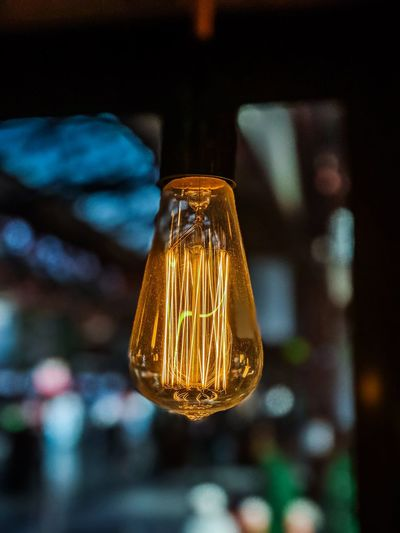 Electricity  Light Bulb Filament Close-up Illuminated Lighting Equipment Focus On Foreground No People Technology Yellow Indoors  Black Background Innovation Day
