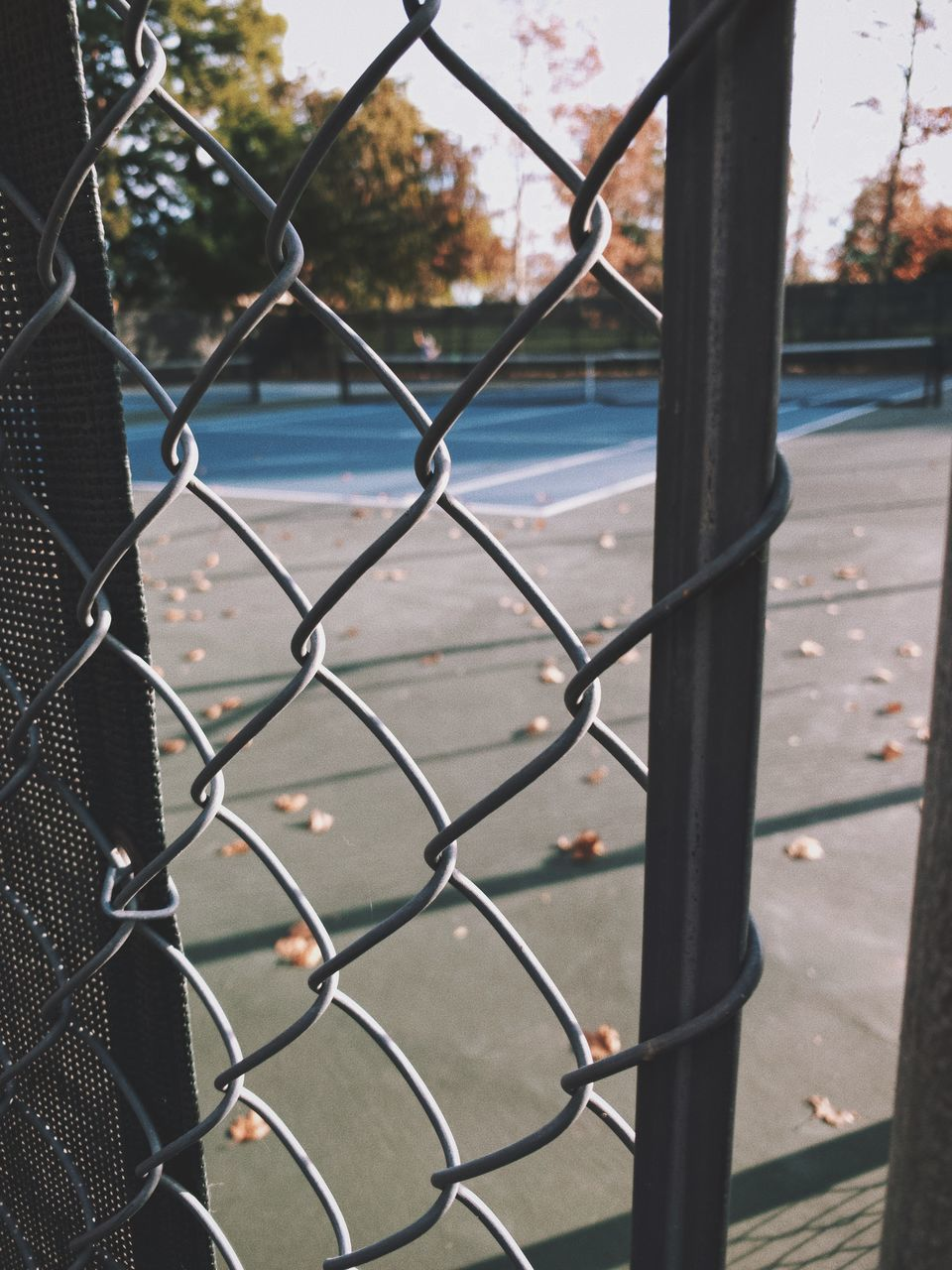 CLOSE-UP OF CHAINLINK FENCE BY CITY