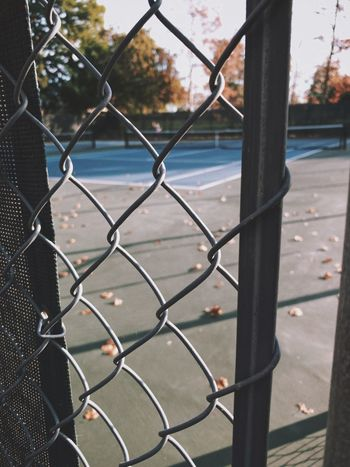 """""""Wishing For Summer"""" An empty tennis court in a local city park begs for the attention of players in a summer game. Fall Autumn Empty Vacant Tennis 🎾 Tenniscourt Chainlink Fence Fence Barrier Boundary Safety Metal Security Protection Sport Focus On Foreground"""
