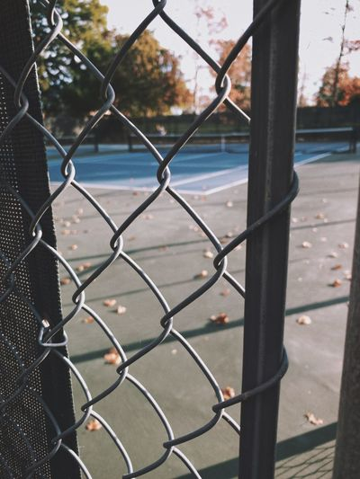 """Wishing For Summer"" An empty tennis court in a local city park begs for the attention of players in a summer game. Fall Autumn Empty Vacant Tennis 🎾 Tenniscourt Chainlink Fence Fence Barrier Boundary Safety Metal Security Protection Sport Focus On Foreground"