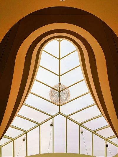Arch Architectural Feature Architecture Backgrounds Built Structure Day Design Diminishing Perspective Directly Below Geometric Shape Illuminated Low Angle View Modern No People Ornate Pattern Repetition Sky Skylight