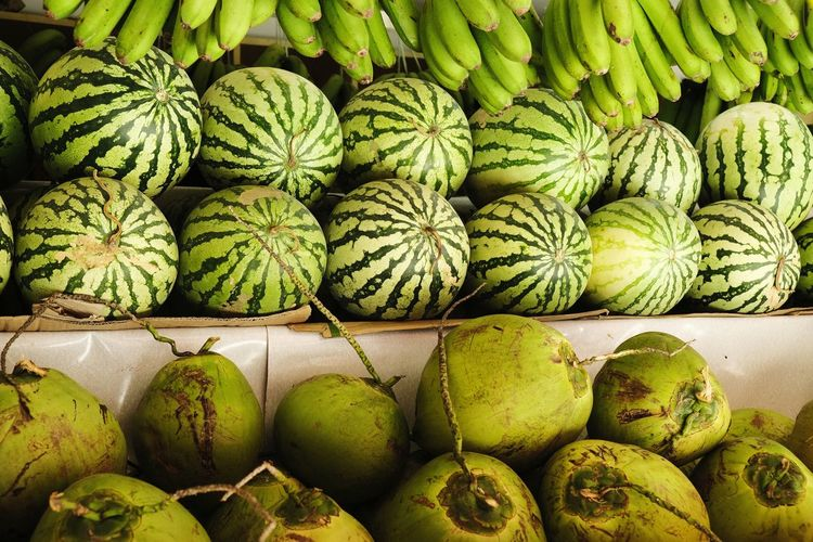 Fruit Fruits Banana Watermelon Coconut Monotone Full Frame Arrangement Close-up Green Color Stall Display Market Stall Street Market Shop Farmer Market Market Various Collection Retail Display For Sale