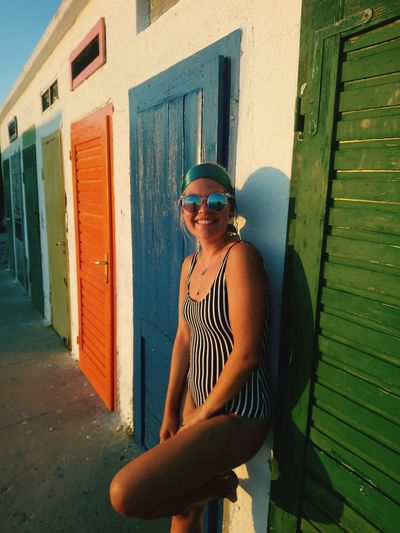 Vintage vibes EyeEm Selects Portrait Standing Looking At Camera Beautiful Woman Women Young Women Building Exterior Architecture Sunglasses Door Beach Closed Door Posing