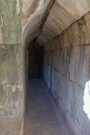 The tunnel leading to a secret entrance from the north-eastern entrance to the Nimrod Fortress located in Upper Galilee in northern Israel on the border with Lebanon. Israel Nimrod Fortress Saladin Beybars Crusaders Ayubids Mamluks Assassins History Heritage Castle Travel Destinations National Park Tourist Attraction  Hill Stone Wall Entrance Gate Tunnel Old Ancient Loophole Medieval Architecture Ruins Protection
