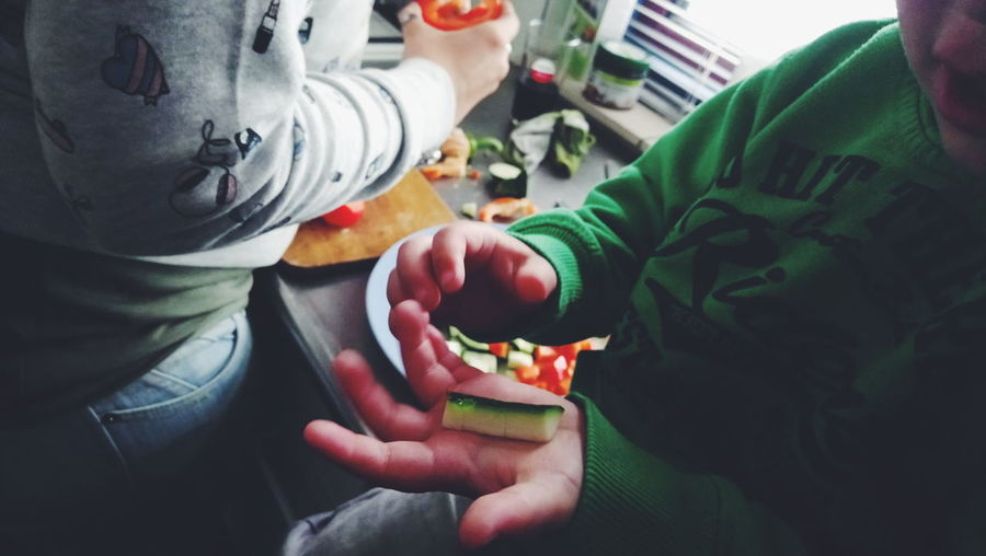 Making dinner. Cooking Food Human Hand Holding Close-up Green Color Food And Drink