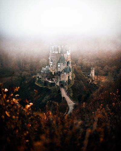 - Castle Eltz - Looks like my new home 😅 Where would you like to live? Architecture Building Exterior Built Structure High Angle View No People Fog Outdoors City Tree Nature Cityscape Day Sky EyeEm Best Shots EyeEm Best Edits Castle EyeEm Nature Lover EyeEm Germany Germany Fortress From Above  Nature Foggy Foggy Morning Landscape EyeEmNewHere