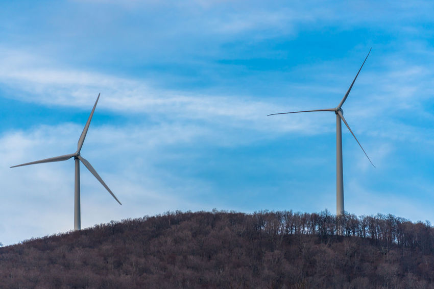 Alternative Energy Day Environmental Conservation Field Fuel And Power Generation Industrial Windmill Low Angle View Nature No People Outdoors Renewable Energy Rural Scene Sky Technology Traditional Windmill Wind Power Wind Turbine Windmill