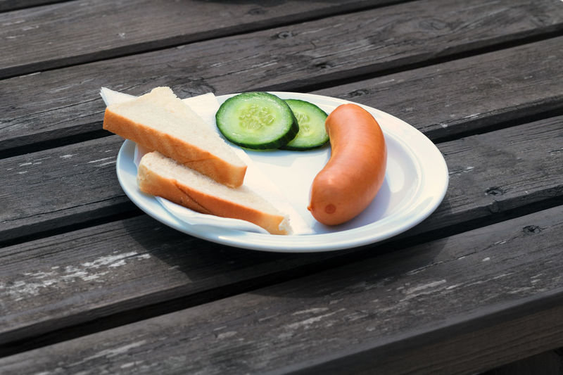 Bock sausage, wieners or Frankfurther sausage with toast and cucumbers on a white plate. Hot Dog Bun Close-up Crispy Sausage Day Food Food And Drink Freshness Healthy Eating High Angle View Indoors  Meat Production Meat Farm Birds No People Ready-to-eat Small Sausages Table Wood - Material