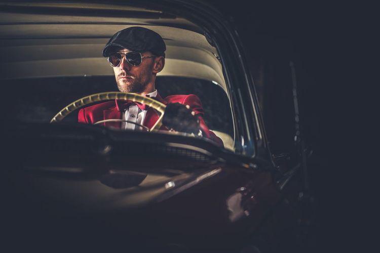 Man Driving Vintage Car At Night