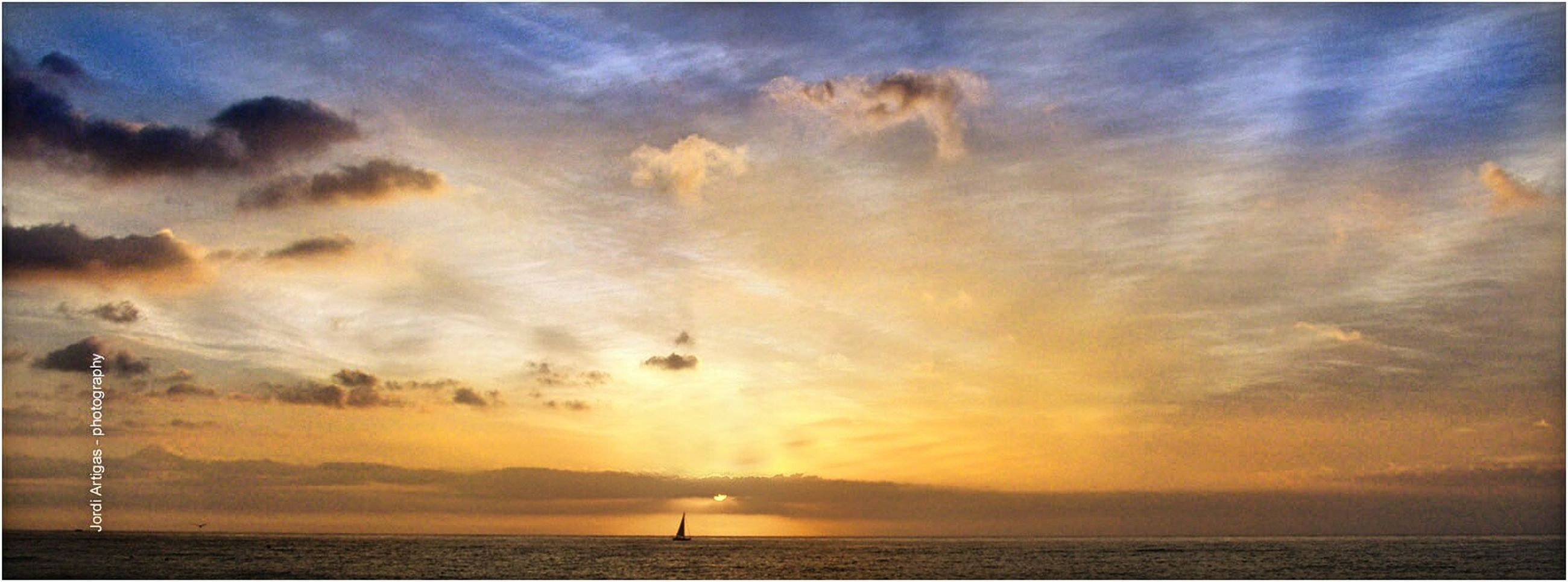 sunset, sky, sea, scenics, water, beauty in nature, tranquil scene, tranquility, horizon over water, cloud - sky, silhouette, idyllic, nature, orange color, cloud, cloudy, waterfront, sun, dramatic sky, outdoors