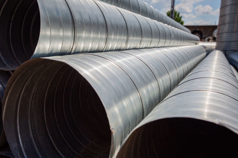 Ventilation pipe warehouse. steel pipes, parts for the construction of air ducts for an industrial