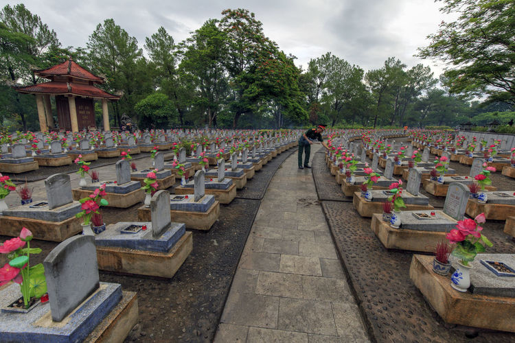 The Truong Son Cemetery in Vinh Tuong Commune, Gio Linh District, Quang Tri Province, Vietnam: July 26, 2018: This is a resting place for more than 60,000 martyrs killed in the Vietnam-US war. Gio Linh Quang Tri Truong Son Cemetery Viet Nam Vinh Tuong Architecture Cemetery Grave Nature Outdoors Plant Religion Tree Truong Son