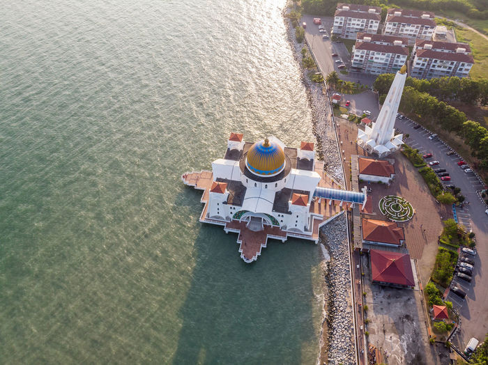 Malacca Straits Mosque, Malaysia High Angle View Water Nature Day Architecture No People Sea Built Structure Outdoors Communication Aerial View Travel Sign Travel Destinations Melaka Malacca Melaka Straits Mosque Malaysia ASIA Mosque Tree