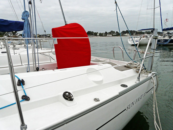 Sunfast37 433 po - 11 m a vessel ! Nautical Equipment Red Red Bar Protection Boat Boat And Water Boat Deck Close-up Day Mode Of Transport Moored Nautical Vessel No People Outdoors Sailboat Taud De Barre A Roue Taud Rouge Transportation Blue Boots Rope Water Voilier Yacht