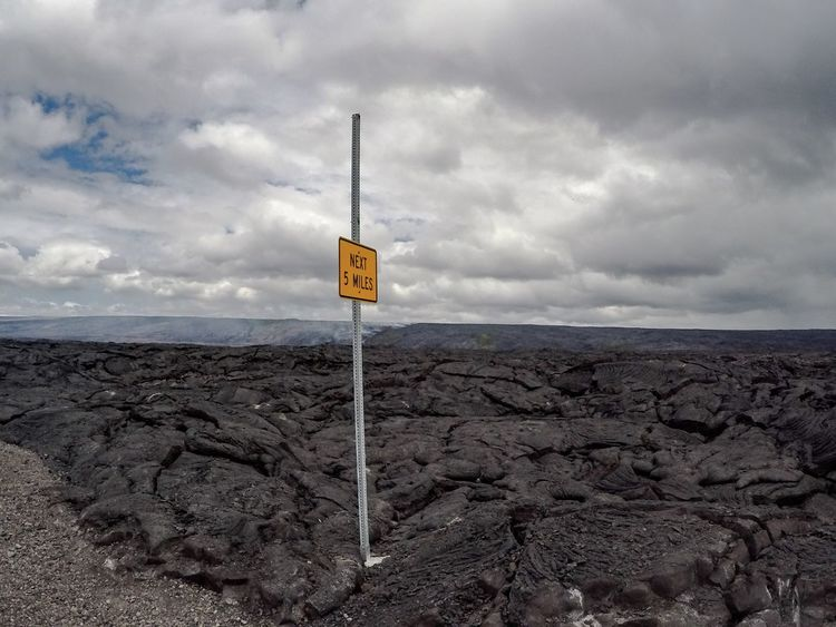 Sky Cloud - Sky Nature Information Sign Beauty In Nature Tranquil Scene Communication Outdoors Landscape Scenics Text No People Tranquility Landscapes Lava Field Hawaii Big Island Big Island Hawaii Volcano Desert Sign Black Extreme Terrain Lava Miles Away