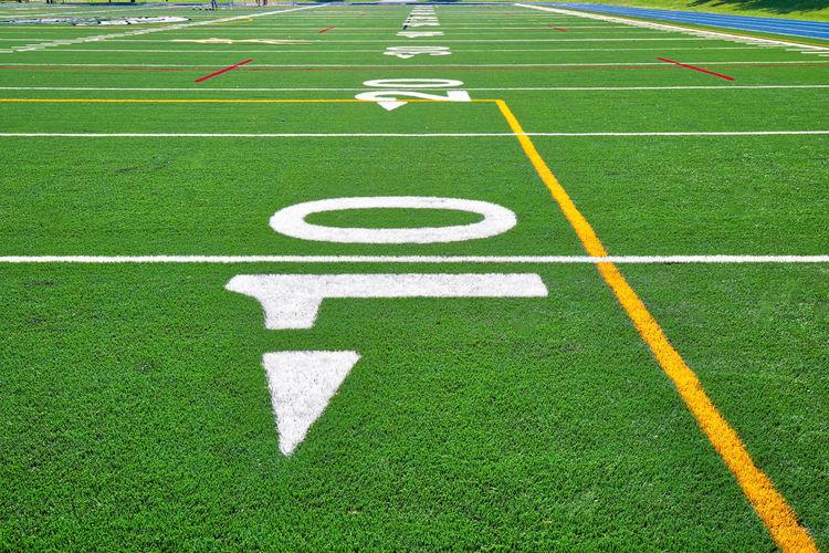 Arrow symbol on green grass