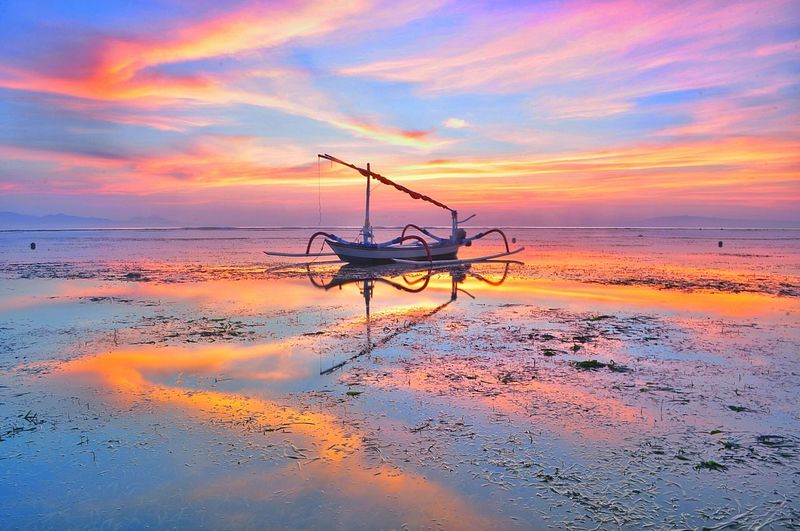 boat reflections #boat #clouds  #Sunrise #sunrise #reflection Water Nautical Vessel Sea Sunset Beach Fisherman Reflection Beauty Sky Horizon Over Water