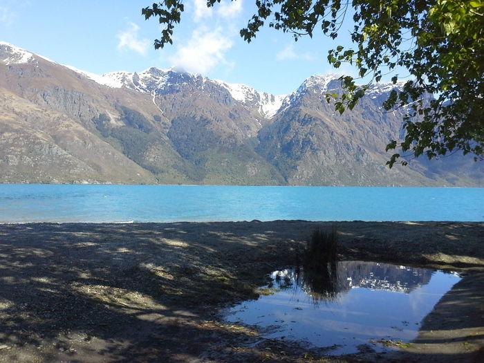 Reflections in Queenstown NZ Beauty In Nature Blue Blue Lake Calm Cloud - Sky Day Idyllic Lake Lake Wakatipu Lakeshore Landscape Mountain Nature New Zealand Scenery The Great Outdoors - 2016 EyeEm Awards Outdoors Queenstown Nz Reflection Scenics Sky Snow Capped Mountains Tranquil Scene Tranquility Tree Water