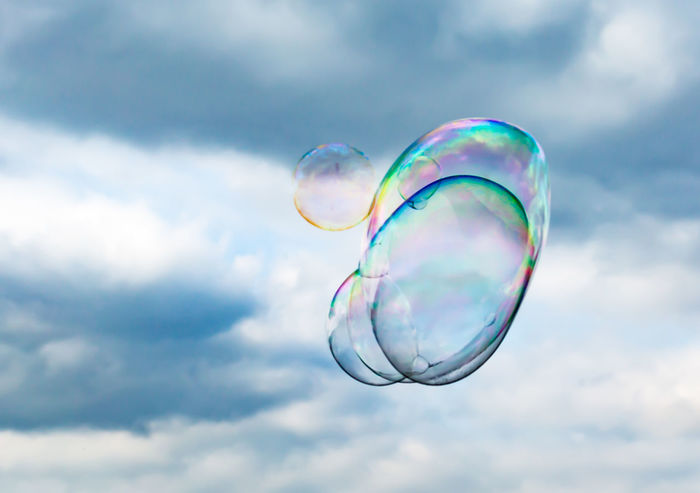 Beauty In Nature Blue Bubble Bubbles Close-up Cloud Cloud - Sky Cloudy Day Focus On Foreground Fragility Universe Low Angle View Mid-air Multi Colored Nature No People Outdoors Rainbow Scenics Sky Soap Bubbles Sphere Tranquility Weather Market Reviewers' Top Picks