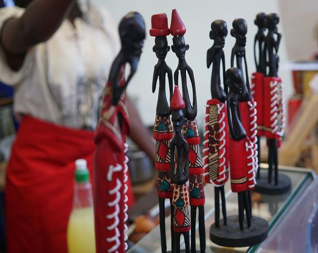 African wooden statuettes illustrating indigenous people in traditional dress African African Art Statue Tradition Art Close-up Figurine  Figurine  Figurines  Floklore Focus On Foreground Group Of Objects Human Representation In A Row Representation Selective Focus Statues Statuette Statuettes Traditional Wooden