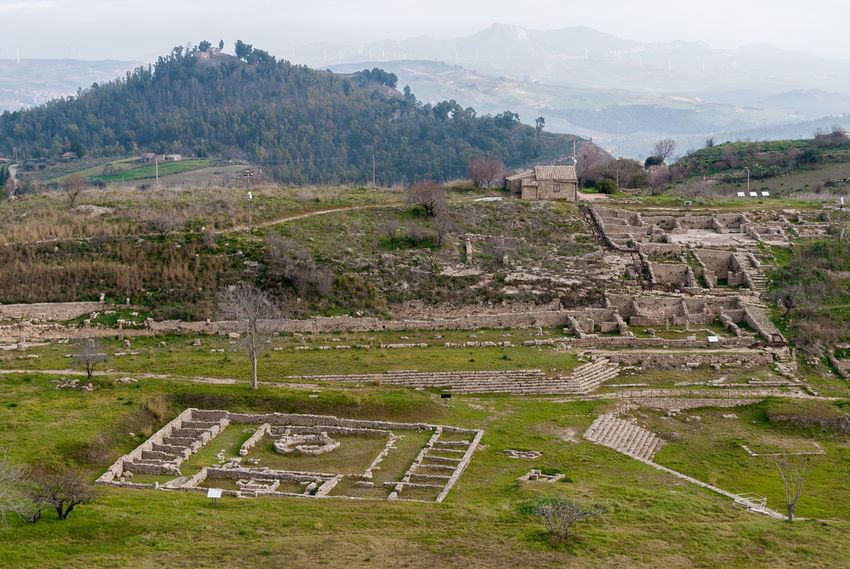 Panoramic view of the ancient greek city of Morgantina, in Sicily Agora Archaeology Archeology Country Enna Greek Green Hills Panoramic Ruins Rural Sicily Touristic Aidone Italy Landmark Landscape Morgantina Outdoors Ruined Scenics Site