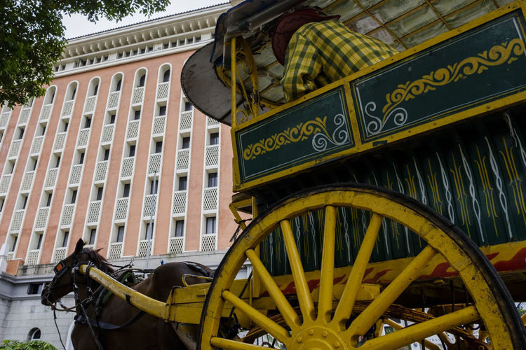 Architecture Building Exterior Built Structure Low Angle View Day Transportation Building City Wheel Text Outdoors No People History Communication The Past Nature Yellow Mode Of Transportation Travel Horse Carriage Horse Carriage Horse Cart My Best Photo