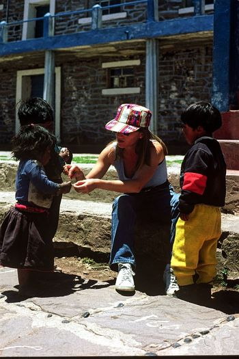 Connected By Travel Togetherness Old Travel Sunlight Vacations Women Real People Day Etnic Village Children Photography Children Life Trip Photo Young Women Childhood Child Colored Clothing Colorful Colored Hat Peru Latin America Tourism This Is Latin America