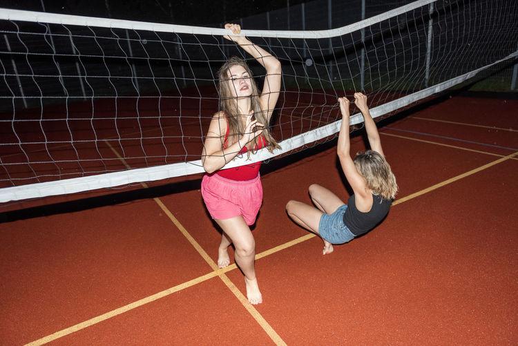 Full length of women holding net