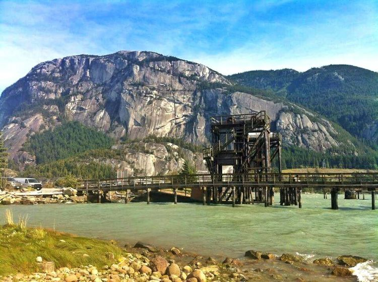 Mountain Nature Sky Landscape Outdoors Architecture No People Water Scenics British Columbia, Canada Squamish Juxtaposition Metal Industry Green Water Blue Sky Interesting View Bridge - Man Made Structure Bridge Canada Photos Adapted To The City