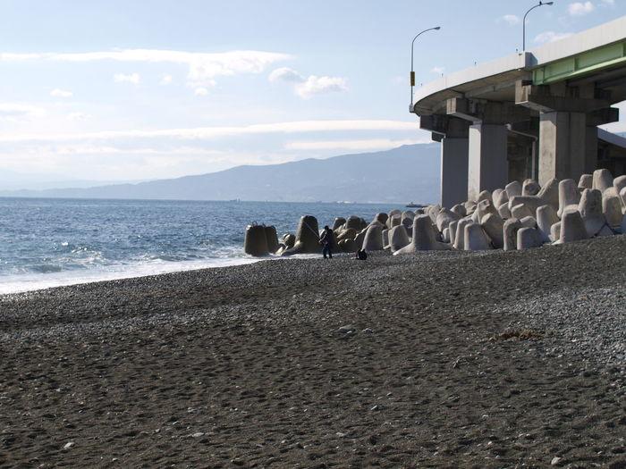 Beach by bridge