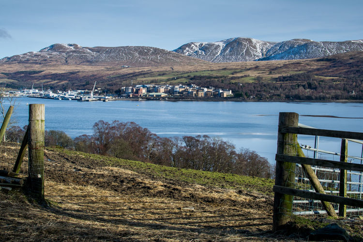 Through the posts Mountain Outdoors Lake Water Sky Landscape Day Nature Beach No People Beauty In Nature Grass Tree Farmland Fence Post Countryside Faslane Naval Base Scotland GareLoch Beautiful Picturesque Military Hillside Farm