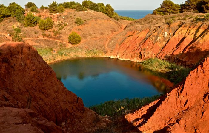 Puglia Red Bauxite Cave Beauty In Nature Geology Italy Landscape Nature Otranto Outdoors Red Sand Salento Travel Destinations Water