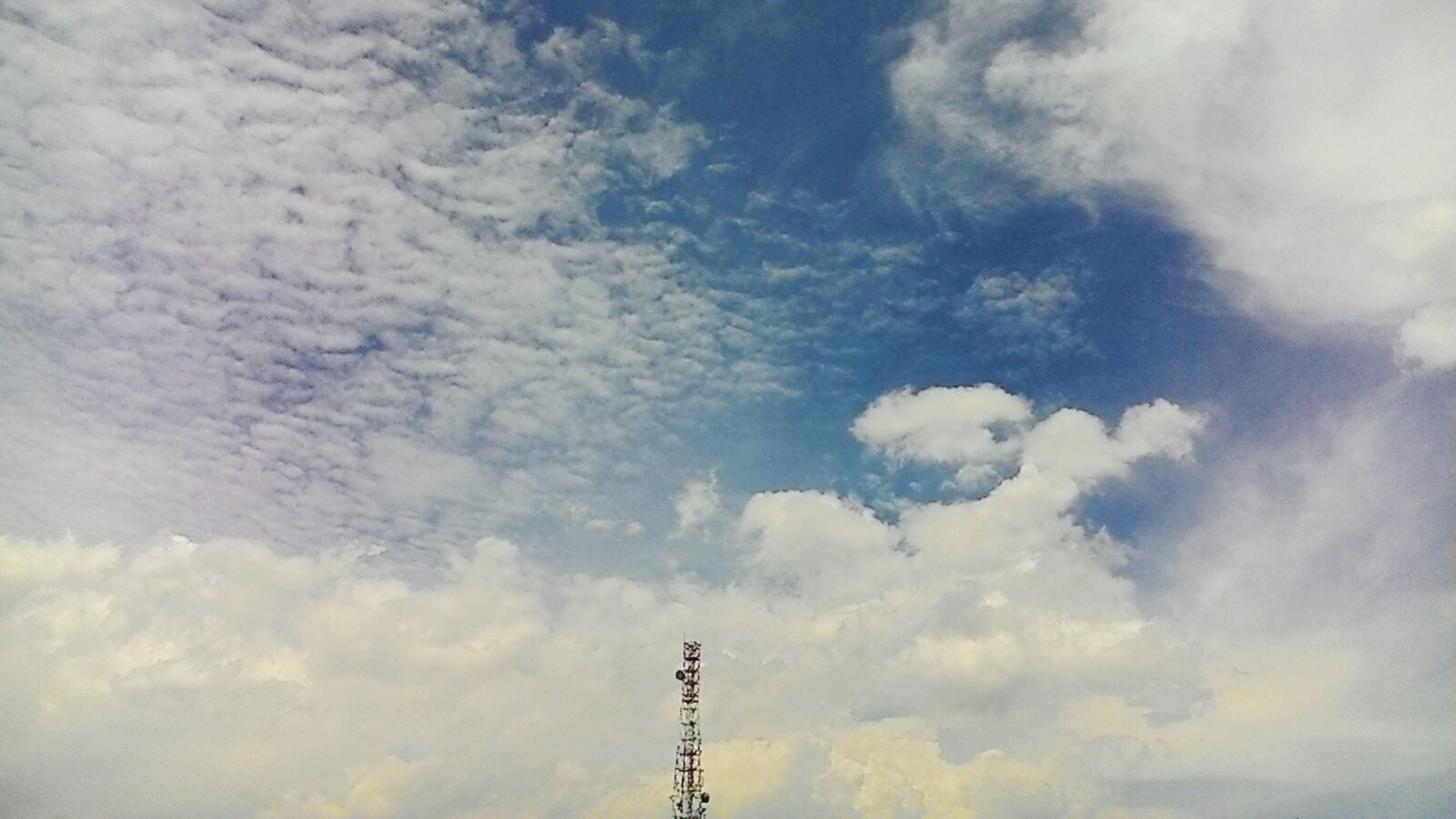 low angle view, sky, cloud - sky, cloudy, cloud, technology, nature, weather, communication, overcast, outdoors, no people, tranquility, electricity pylon, connection, day, beauty in nature, power line, silhouette, electricity