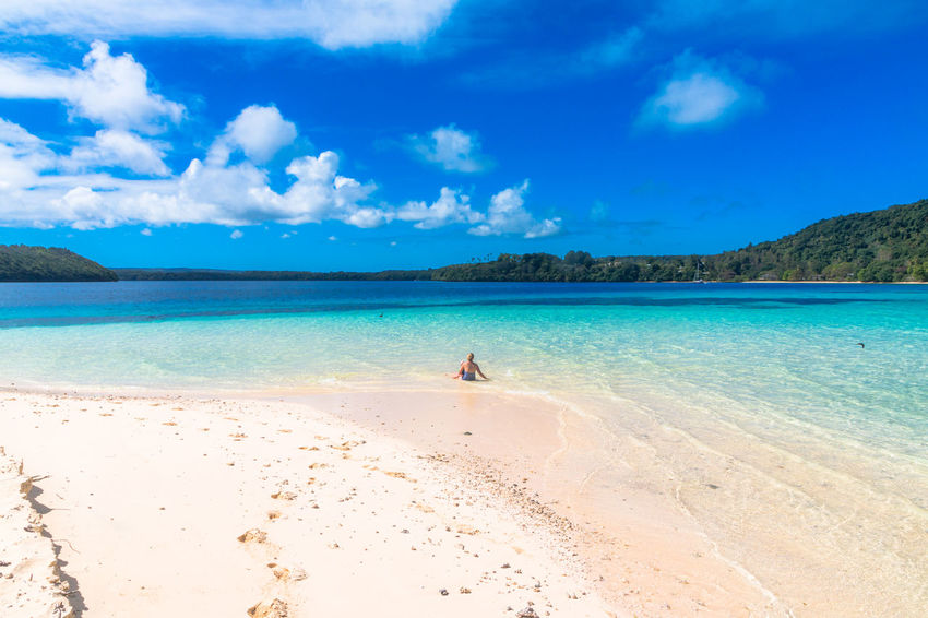 Adult Beach Beauty Blue Cloud - Sky Day Full Length Horizon Over Water Human Body Part Idyllic Nature One Person Outdoors Palm People Postcard Sand Sea Sky Summer Sun Travel Travel Destinations Tropical Climate Vacations