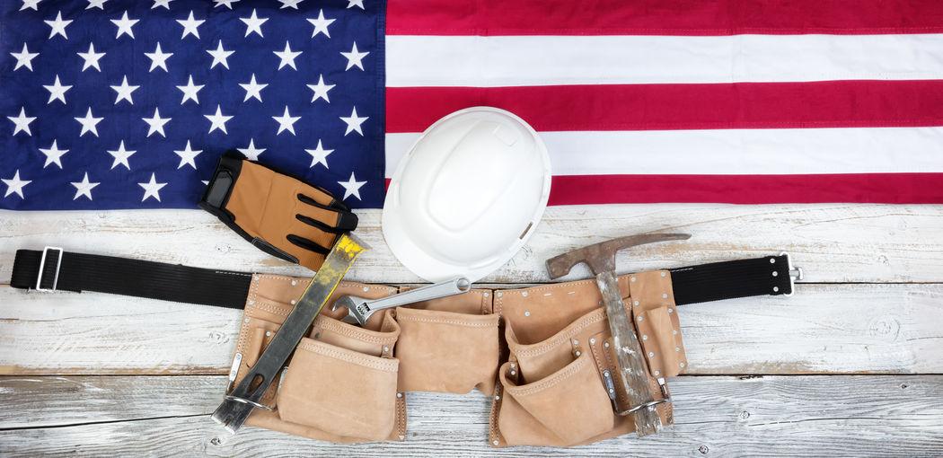 High Angle View Of American Flag And Work Tool On Table