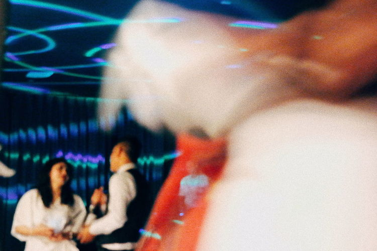 Blurred motion of people sitting at music concert