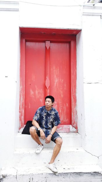 Watarun Watarunbangkok Bangkok Thailand. Full Length Sitting Portrait Men Smiling Red Working Happiness Mid Adult Building Exterior Door Door Knocker