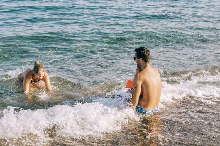 Happy family enjoying at seashore