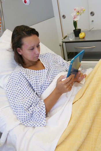 Young Woman Hospital Room Bed Tablet Belgium