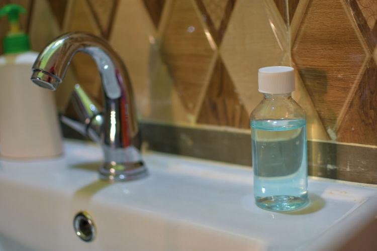 Close-up of hand sanitizer at sink i bathroom