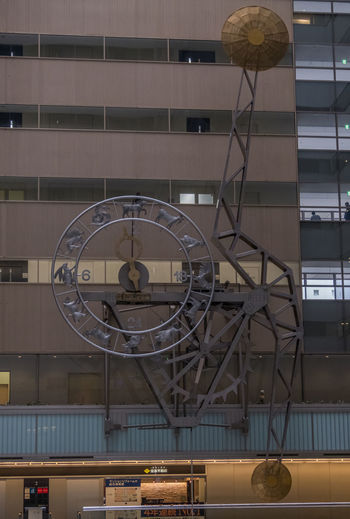 Low angle view of clock in building