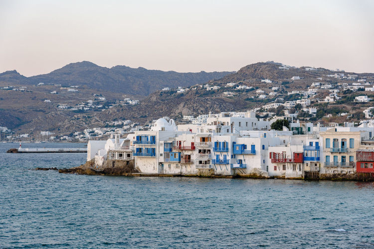 The Little Venice part of Mykonos at dusk Architecture Bay Beauty In Nature Building Building Exterior Built Structure City Cyclades Day Greece Little Venice Little Venice Mykonos Mountain Mykonos Nature No People Outdoors Residential District Scenics - Nature Sea Sky Town View Into Land Water Waterfront
