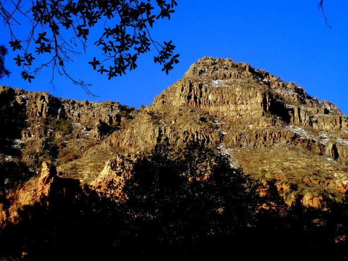 Sedona, Arizona USA Beauty In Nature Blue Clear Sky Day Eroded Geology Landscape Low Angle View Mountain Nature No People Oak Creek Outdoors Physical Geography Rock - Object Rock Formation Rocky Mountains Scenics Sky Sunlight Tourism Tranquil Scene Tranquility Travel Destinations Tree
